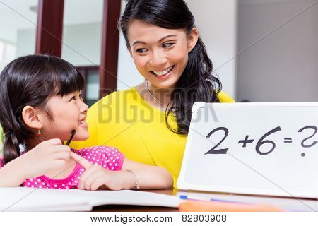 Chinese mother teaching mathematics to child