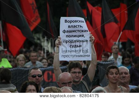 The Person With The Oppositional Poster On Meeting In Protection Of Political Prisoners
