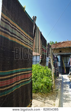 Cleaning And Hand Washing The Rugs In The Village