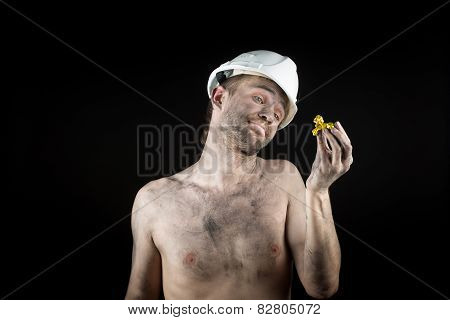 miner shows a golden nugget