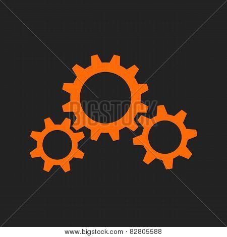 Three Orange Gear Wheels On Black