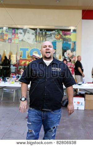 LAS VEGAS -OCT 10: Johnny Jimenez speaks to a crowd . The Toy Shack, on October 10, 2014. Johnny Jimenez is also a toy appraiser on the reality TV show Pawn Stars.
