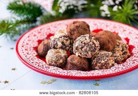Assorted Dark Chocolate Truffles On Red Plate