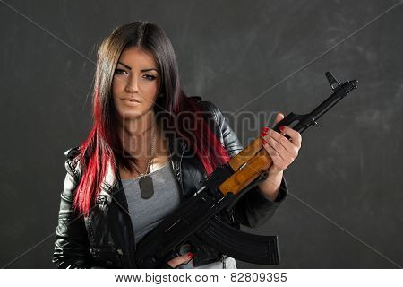 Attractive Young Woman With Rifle