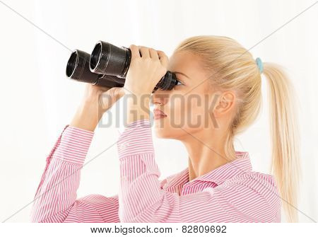 Young Woman Looking Through Binoculars