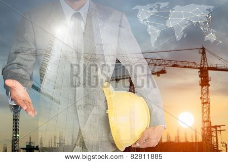 Businessman With Handshake To Cooperation And Construction Building Background