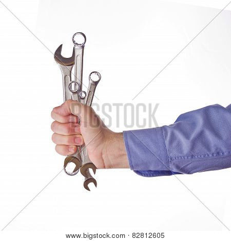 Male Worker's Hand Holding Set Of Wrenches