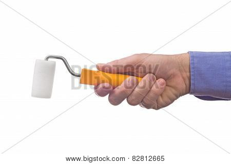 Male Worker's Hand Holding Paint Roller