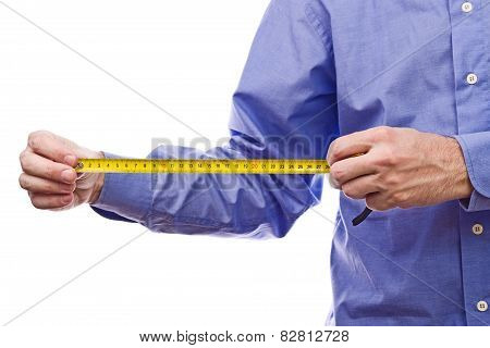 Male Worker's Hand Holding Self-retracting Tape Measure Meter