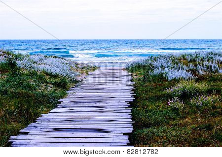 Old wooden pier to the sea backgrou