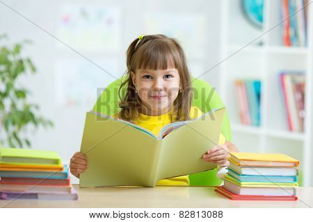 smiling child with opened book