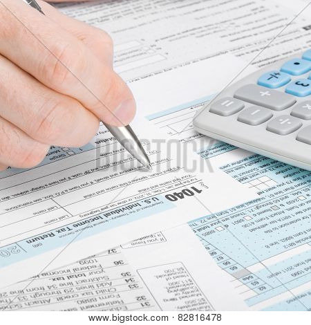 United States Of America Tax Form 1040 - Man Filling Out Tax Form