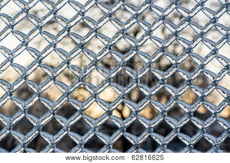 Thick Frozen Ice On A Metal Chain Link Fence