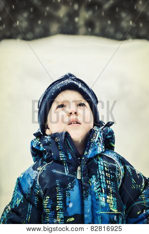 Boy Looking Up At Snow Falling - Retro