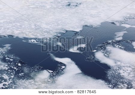 Cracked Ice Floes On A Frozen Sea, Winter Cold Background