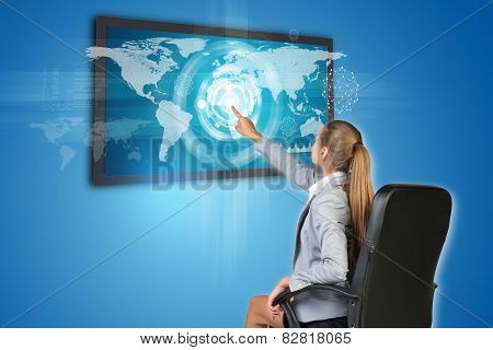 Businesswoman operating touch screen interface