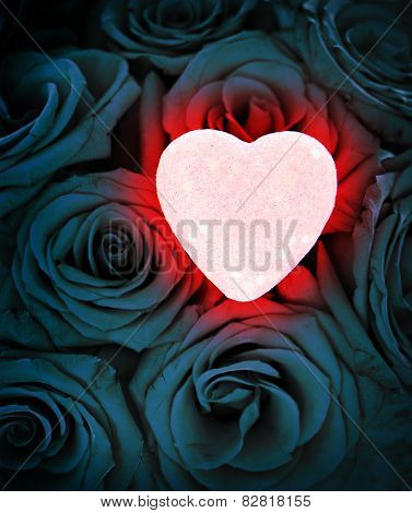 Pink Glowing Heart On Blue Roses
