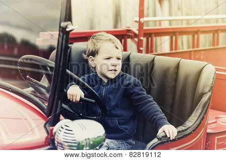 Boy In A Vintage Fire Truck - Retro