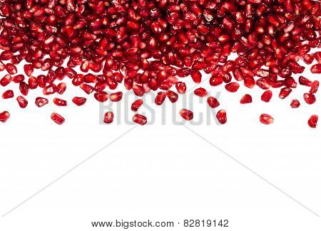Scattered On Top Pomegranate Seeds, Can Be Used As A Background, Isolated On A White