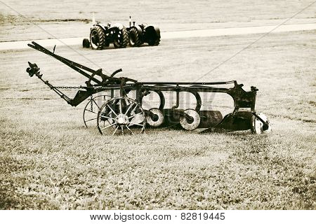 Vintage Plow In A Farm Field