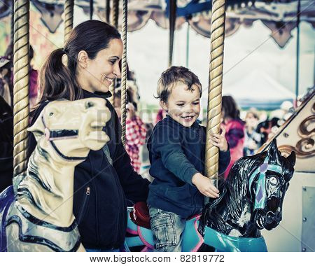 Boy And Mother Together On A Carousel Ride - Retro