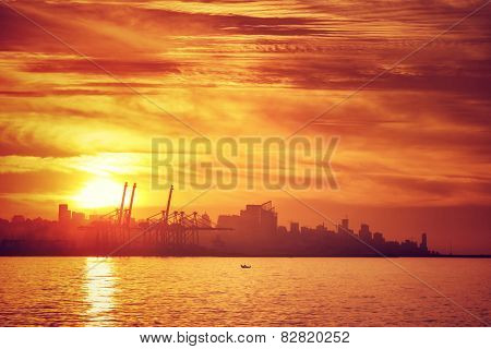 Silhouette of coastal city in beautiful orange sunset light, gorgeous cityscape, panoramic landscape, summer travel, Beirut, Lebanon