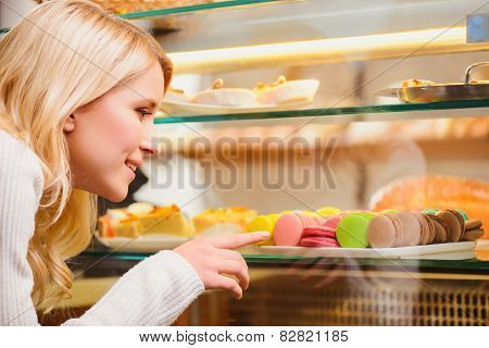 Beautiful young woman in a confectionery