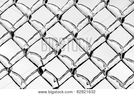 Thick Ice On A Metal Chain Link Fence - Black And White