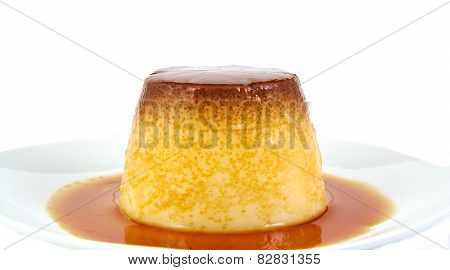Creme caramel, custard or pudding isolated on white background