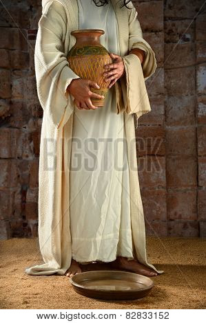 Jesus standing and holding water jar ready to wash the disciples' feet