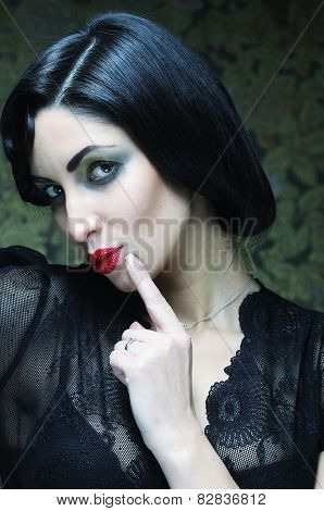 Fashion art girl portrait.Vamp style. Glamour vampire woman.Studio shot.