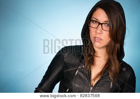 Indifferent Young Adult Female Wearing Black Leather Coat Hoodie
