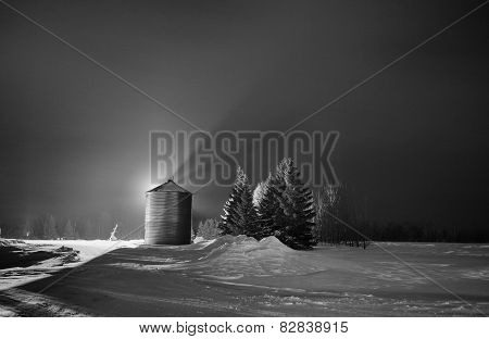 Grain bin at night
