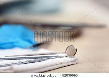 Set dentist tools on napkin on table close up