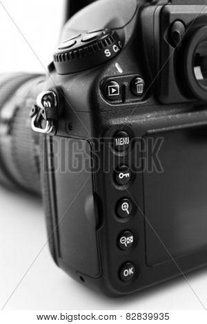 Digital camera on light background