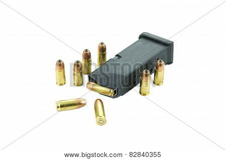 9mm bullets and magazine isolated on white background.
