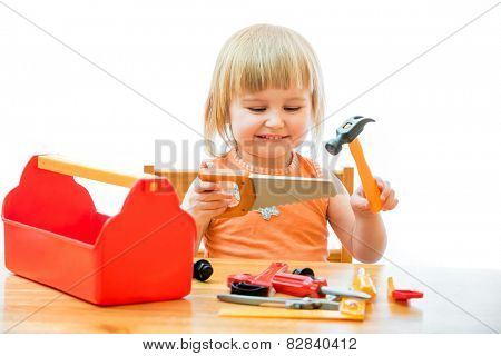cute little kid with toy tools isolated on a white background
