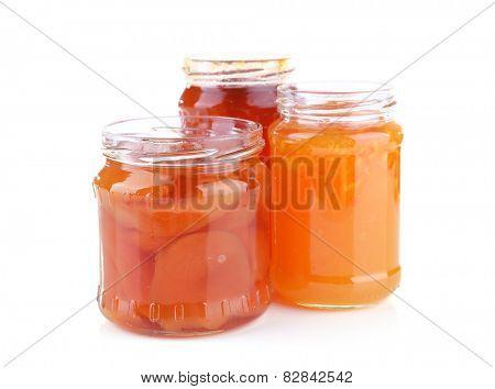 Homemade jars of fruits jam isolated on white background