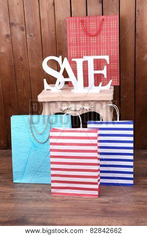Sale with bags on side table in room