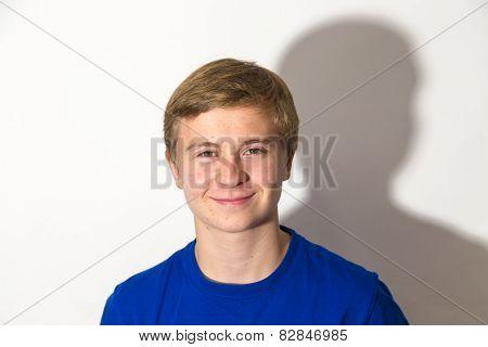 Portrait Of Cute Boy In Puberty
