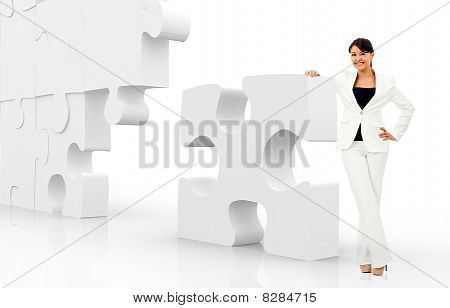Business Woman Leaning On A Puzzle
