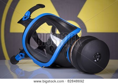 Gas mask against toxic symbol background