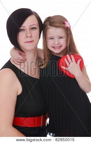 Close-up little girl hugging beloved mother.