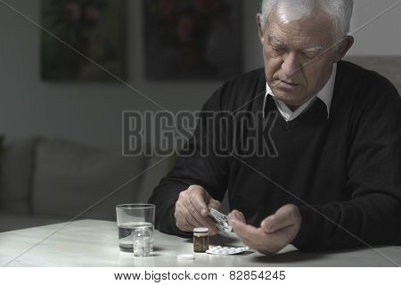 Man Taking Medicaments
