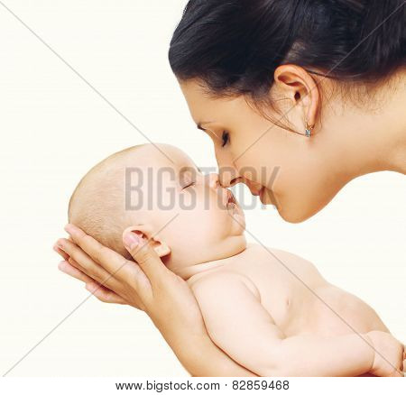 Baby Sleeping Sweetly On Mother's Arms