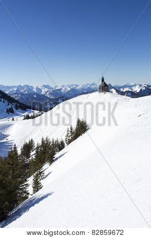 Wallberg mountain with chapel in winter, Bavaria, Germany