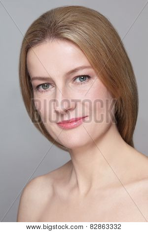 Portrait of beautiful smiling mature woman with clean make-up