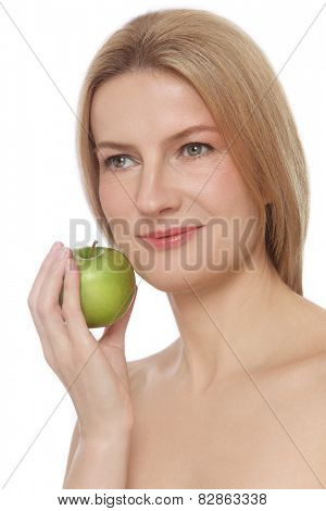 Portrait of beautiful smiling mature woman with clear skin and green apple in her hand over white background