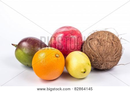 isolated group of exotic fruits - coconut, mango, pomegranate and citrus