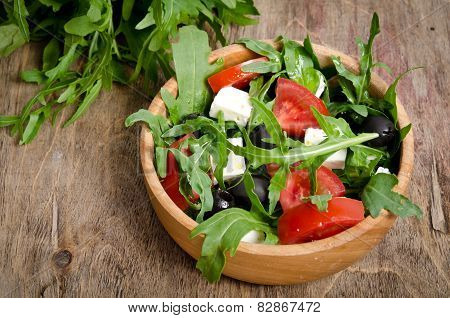 Greek Salad In A Wooden Salad Bowl On The Table